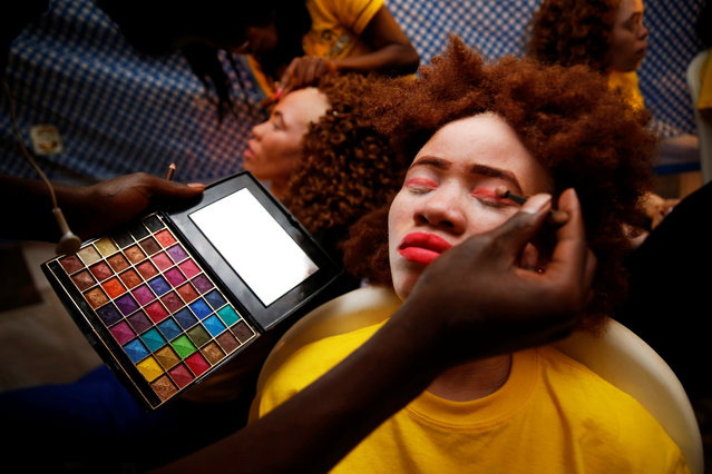A make up artist works on a participant back stage before the Mr & Miss Albinism Kenya Beauty Pageant 2018 in Nairobi, Kenya, November 30, 2018. (Photo by Baz Ratner/Reuters)