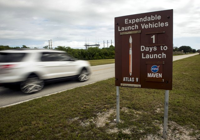 A sign along the NASA Kennedy Space Center causeway displays to passersby that there is one day remaining until the scheduled launch of the United Launch Alliance Atlas V rocket with NASA's Mars Atmosphere and Volatile Evolution (MAVEN) spacecraft onboard from Cape Canaveral Air Force Station Space Launch Complex 41, Sunday, Nov. 17, 2013, in Cape Canaveral, Fla. (AP Photo/NASA, Bill Ingalls)