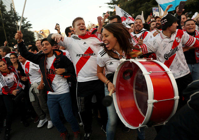 River Plate fans outside the stadium before the second leg match of the all-Argentine Copa Libertadores final against Boca Juniors, at the Santiago Bernabeu stadium in Madrid, on December 9, 2018. River Plate came from behind to beat bitter Argentine rivals Boca Juniors 3-1 in extra time. (Photo by Susana Vera/Reuters)