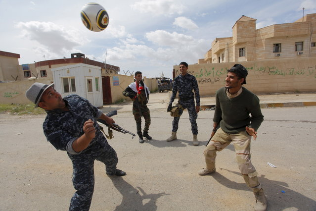 Members of the Iraqi security forces play soccer in Tikrit April 1, 2015. (Photo by Alaa Al-Marjani/Reuters)