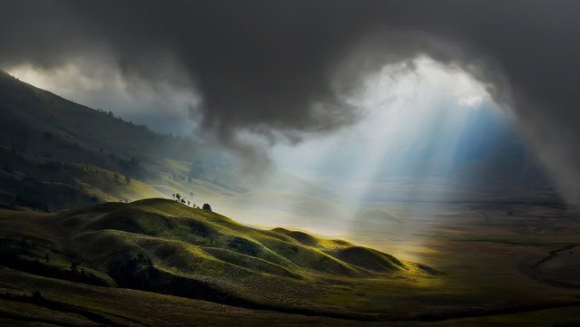 """Light From Heaven"". Taken around Mount Bromo, East Java, Indonesia in the morning. Photo location: East Java, Indonesia. (Photo and caption by Pimpin Nagawan/National Geographic Photo Contest)"