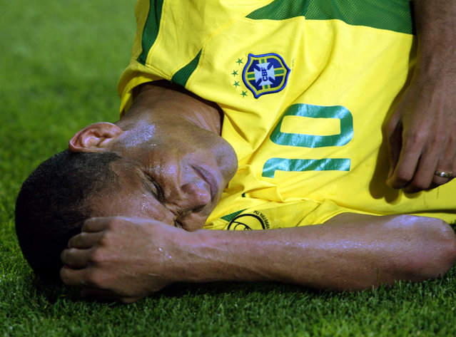 Brazilian midfielder Rivaldo lies near the corner flag in the closing moments of the World Cup Finals match between Brazil and Turkey June 2002. (Photo by Desmond Boylan/Reuters)