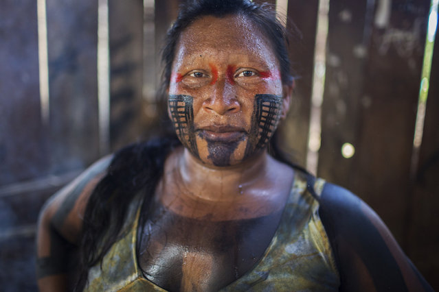 """Ngrenhkaroti is known by her friends and family as Sappa, or """"female frog"""". The Xikrin marry young – usually from 13 to 16 for girls – and although Sappa is still in her thirties, she is a grandmother. (Taylor Weidman)"""