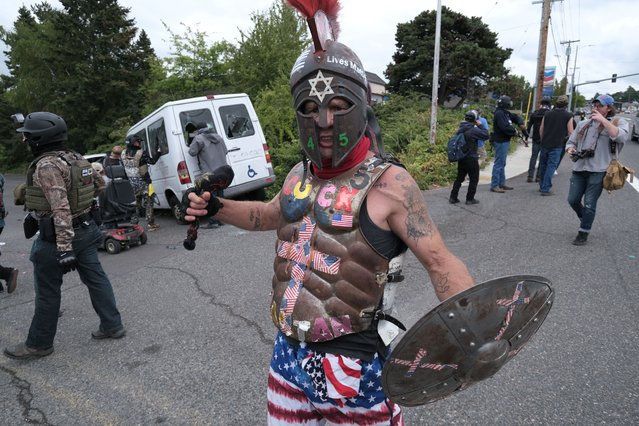 """""""Cuck Spartan"""" is enraged after anti-fascist protesters drove a van into a Proud Boys rally on Sunday, August 22, 2021, in Portland, Ore. (Photo by Alex Milan Tracy/AP Photo)"""