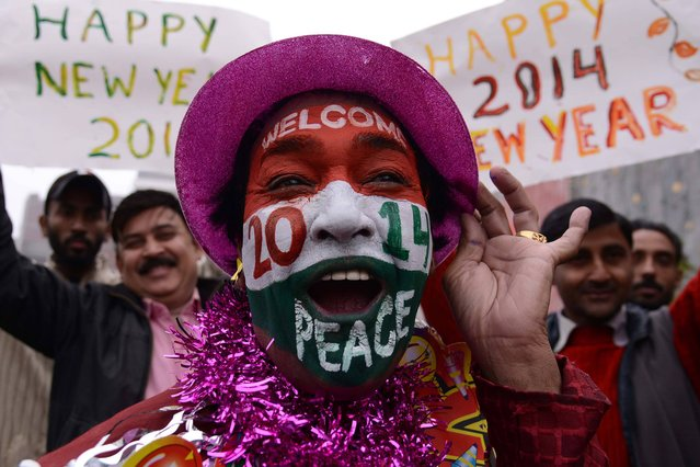 An Indian reveller poses on New Year's Eve in Amritsar on December 31, 2013. Indians are preparing to welcome 2014, in contrast to last year which saw the country cancel most of its official New Year's celebrations after the fatal gangrape of a student on a New Delhi bus on December 16, which sparked protests and a year of introspection about women's rights. (Photo by Narinder Nanu/AFP Photo)