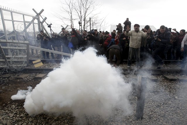 Stranded refugees and migrants flee tear gas fire by the Macedonian police, after trying to bring down part of the border fence during a protest at the Greek-Macedonian border, near the Greek village of Idomeni, February 29, 2016. (Photo by Alexandros Avramidis/Reuters)