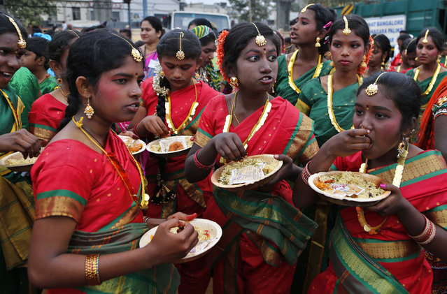 School children dressed in traditional attire eat breakfast before participating in a Republic day parade in Bangalore, India, Thursday, January 26, 2017. (Photo by Aijaz Rahi/AP Photo)