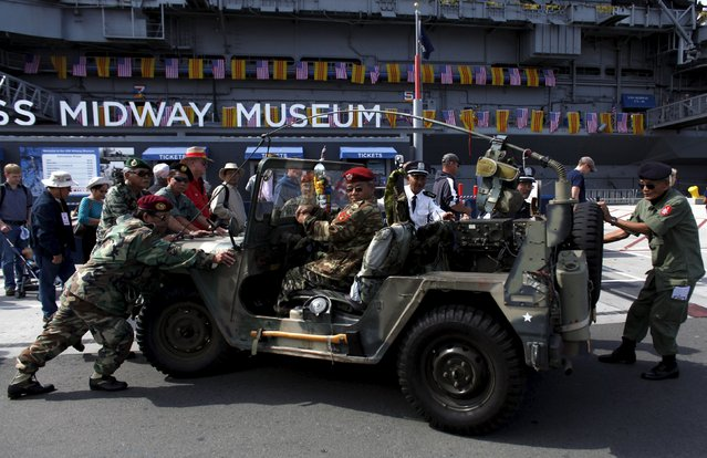 Former Vietnamese military position a vintage jeep near the USS Midway during a day-long ceremony commemorating the 40th Anniversary of Operation Frequent Wind and the fall of Saigon in San Diego, California, United States April 26, 2015. (Photo by Mike Blake/Reuters)