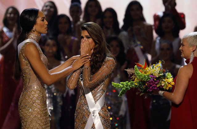 Miss France Iris Mittenaere reacts after she won the 65th Miss Universe beauty pageant at the Mall of Asia Arena, in Pasay, Metro Manila, Philippines January 30, 2017. At left is First Runner up Miss Haiti Jacque Pellisier. (Photo by Erik De Castro/Reuters)