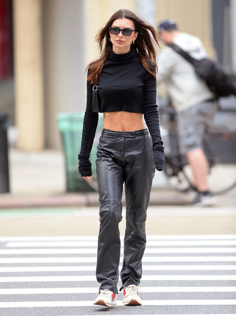 Emily Ratajkowski is seen going for a walk in Tribeca New York City on September 22, 2021. The model wears a cut-off black top with black leather trousers. (Photo by Elder Ordonez/Splash News and Pictures)