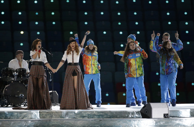 Russian duo t.A.T.u. Lena Katina, third from left, and Yulia Volkova, second from left,  perform on stage before the opening ceremony of the 2014 Winter Olympics in Sochi, Russia, Friday, February 7, 2014. (Photo by Mark Humphrey/AP Photo)