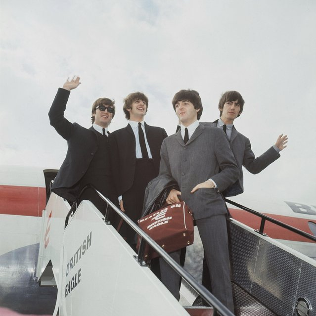 The Beatles leave London airport in 1964. From left:  John Lennon, Ringo Starr, Paul McCartney and George Harrison. (Photo by AP Photo)