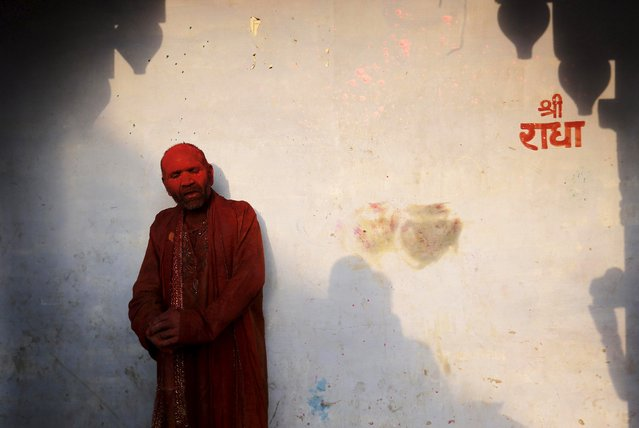 A Hindu devotee takes part in the religious festival of Holi, also known as the festival of colours, in the Nandgaon temple in Mathura in the Uttar Pradesh region of India, March 18, 2016. (Photo by Anindito Mukherjee/Reuters)