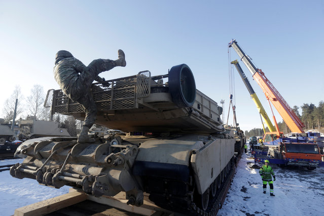 U.S. M1 Abrams tank which will be deployed in Latvia for NATO's Operation Atlantic Resolve is prepared to be unloaded in Garkalne, Latvia February 8, 2017. (Photo by Ints Kalnins/Reuters)
