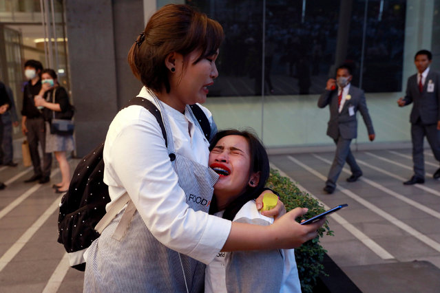 A woman cries after the Central World Complex was evacuated due to a fire, in Bangkok, Thailand, April 10, 2019. (Photo by Soe Zeya Tun/Reuters)