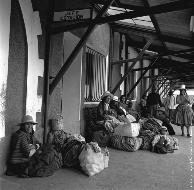 Passengers wait for the next train at Cuzco railway station, central Peru, 1950