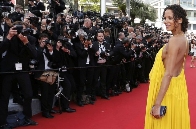 """Model Noemie Lenoir poses on the red carpet as she arrives for the opening ceremony and the screening of the film """"La tete haute"""" out of competition during the 68th Cannes Film Festival in Cannes, southern France, May 13, 2015. (Photo by Regis Duvignau/Reuters)"""