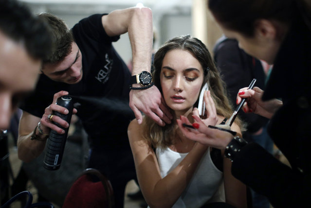 A model has her makeup and hair done during Tbilisi Fashion Week in Tbilisi, Georgia, April 1, 2016. (Photo by David Mdzinarishvili/Reuters)