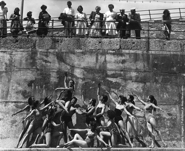 Members of the London Theatre Ballet Company form a frieze-like tableau on the beach at Eastbourne, 1951