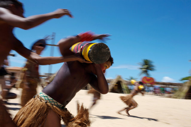 Native Brazilians compete in a tora competition, which is a race while carrying a log, during the Indigenous Youth Games of Pataxos nation in Santa Cruz de Cabralia, Bahia state, Brazil, April 18, 2016. (Photo by Roosevelt Cassio/Reuters)