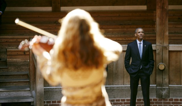 U.S. President Barack Obama watches a selection of songs and excerpts from Hamlet as he tours the Globe Theatre in London to mark the 400th anniversary of William Shakespeare's death April 23, 2016. (Photo by Kevin Lamarque/Reuters)