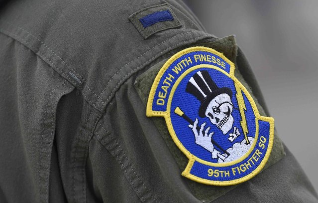 A squadron badge is seen on the uniform of a U.S. F-22 Raptor fighter pilot at R.A.F. Mildenhall in Britain, April 25, 2016. (Photo by Toby Melville/Reuters)