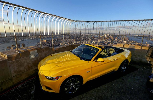 The 2015 Ford Mustang convertible, assembled overnight, sits on the observation deck of the Empire State Building. (Photo by Hiroko Masuike/The New York Times)
