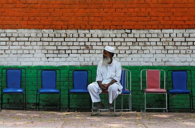 A Muslim man sits on a chair on a roadside pavement in New Delhi, August 1, 2019. (Photo by Anushree Fadnavis/Reuters)