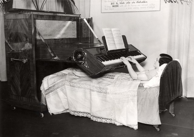 A British woman plays a piano designed especially for people who are confined to bed. Date: 1935. (Photo by Mary Evans Picture Library/Caters News)