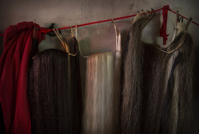 Fake beards used by Sichuan Opera performers from the Jinyuan Opera Company are seen backstage during a performance for villagers at the Dongyue Temple on May 3, 2016 in Cangshan, Sichuan province, China. (Photo by Kevin Frayer/Getty Images)