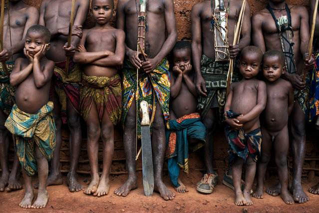 """""""Pygmies"""". On the way to the north east of DRC i came across this fantastic village where a small Pygmies group lives, they were very happy to invite me to their house. During this shoot i realised that the children had a unique and intense expression so i focused just on them, leaving the adults out from the camera. Photo location:  Ituri Forest, Congo. (Photo and caption by Passarini Mattia/National Geographic Photo Contest)"""