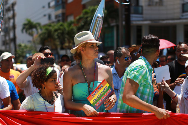 U.S. transgender actress Candis Cayne (C) takes part in the Annual March against Homophobia and Transphobia in Havana, May 14, 2016. (Photo by Alexandre Meneghini/Reuters)
