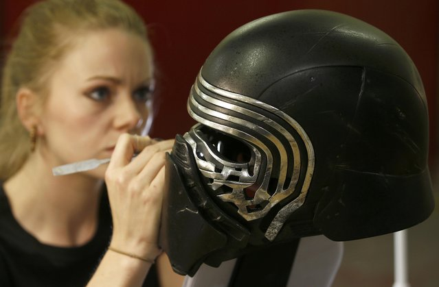 "A technician adds finishing touches to a replica of Kylo Ren's helmet from ""Star Wars: The Force Awakens"", in the Propshop headquarters at Pinewood Studios near London, Britain May 25, 2016. (Photo by Peter Nicholls/Reuters)"
