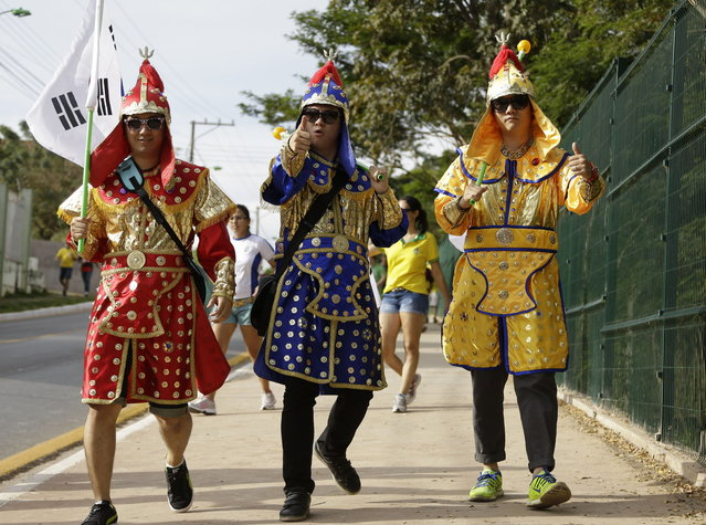 A South Korean fans arrive to the Arena Pantanal before the group H World Cup soccer match between Russia and South Korea in Cuiaba, Brazil, Tuesday, June 17, 2014. (Photo by Thanassis Stavrakis/AP Photo)