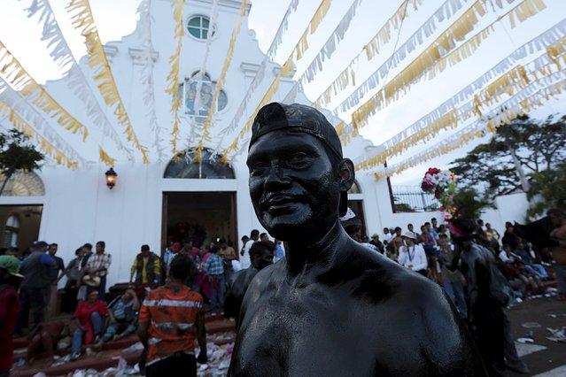 A devotee covered in motor oil takes part in celebrations honoring the patron saint of Managua, Santo Domingo de Guzman, in Managua, Nicaragua August 1, 2015. (Photo by Oswaldo Rivas/Reuters)