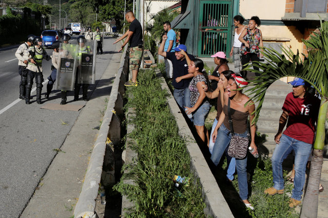 People shout at riot police during a protest over food shortage in Caracas, Venezuela June 9, 2016. (Photo by Marco Bello/Reuters)