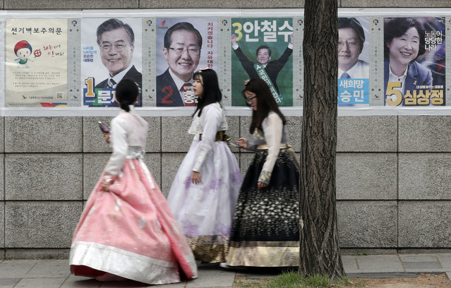 Women walk by posters showing candidates for the presidential election in Seoul, South Korea, Tuesday, May 9, 2017. South Koreans voted Tuesday for a new president, with victory widely predicted for a liberal candidate who has pledged to improve ties with North Korea, re-examine a contentious U.S. missile defense shield and push sweeping economic changes. (Photo by Lee Jin-man/AP Photo)