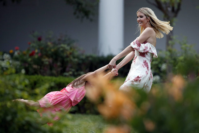 Ivanka Trump, the daughter and assistant to President Donald Trump, swings her daughter Arabella Kushner in the Rose Garden at the Congressional Picnic on the South Lawn of the White House, Thursday, June 22, 2017, in Washington. (Photo by Alex Brandon/AP Photo)