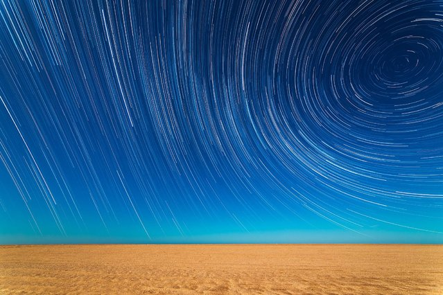 Star Trails on the Beach by Sebastián Guillermaz (Argentina). Multiple shots have been used to produce a time-lapse effect, as the Earth's rotation draws the light from the stars into long trails arcing over the beach in Mar de Ajo, Buenos Aires Province, Argentina. (Photo by Sebastián Guillermaz)