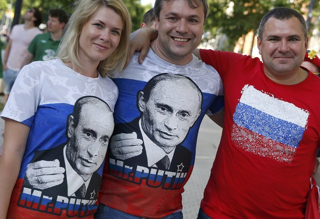 Football Soccer, EURO 2016, Toulouse, France on June 20, 2016. Russia fans wear Putin t-shirst ahead of Russia's game against Wales in Toulouse, France. (Photo by Baz Ratner/Reuters)