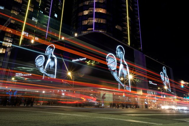The streets in L.A. are lit up with images of NBA basketball star Kobe Bryant as fans pay their respects outside the Staples Center in Los Angeles, California, January 27, 2020. (Photo by Mike Blake/Reuters)