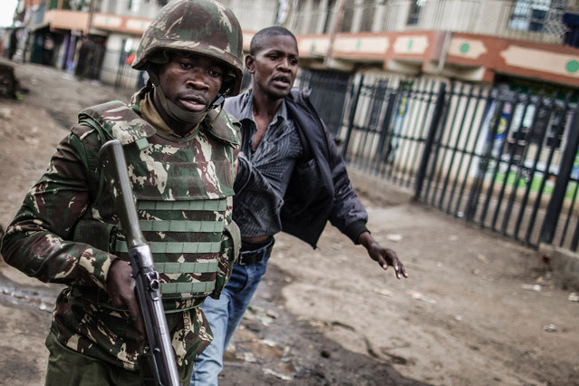 A man is detained in an area of Mathare slum in Nairobi during clashes that followed the killing of a man shot in the head allegedly by Kenyan police on August 9, 2017, a day after general elections. Kenyan police shot dead two protesters in the capital's flashpoint Mathare slum on August 9, as unrest broke out after opposition accusations that the general election was rigged, a senior officer told AFP. (Photo by Marco Longari/AFP Photo)