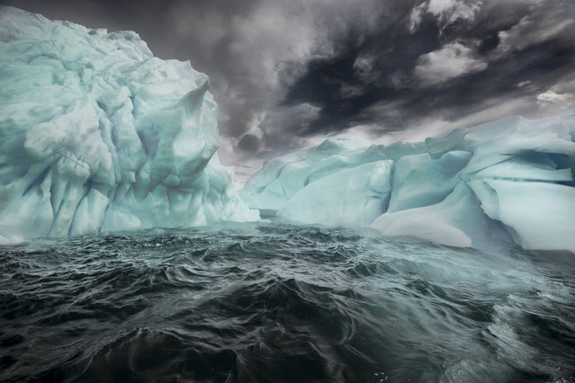 "A serene turquoise glow glimmers from underneath these powerful icebergs. Stood in the middle of Antarctica, the giant icebergs appear to be from an unearthly world. These stunning photographs were captured by American photographer Michael Leggero. ""My images show pure nature, as that is how I describe Antarctica, simply pure nature"", says the 43 year old, of Carthage, New York. ""It is the only place on our planet that humans have not left a presence behind"". (Photo by Michael Leggero/Hotspotmedia/Visual Press Agency)"