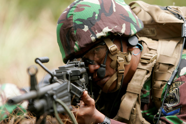 An Indonesian Marine sets up a perimeter defense during a helicopter insertion exercise with US Marines in the Kahuku mountains training area during the multi-national military exercise RIMPAC in Honolulu, Hawaii, U.S. July 13, 2016. (Photo by Hugh Gentry/Reuters)