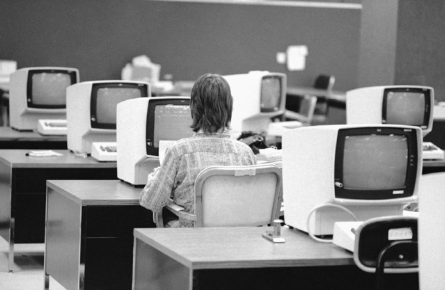 A part-timer, working at a New York City health insurance firm August 8, 1978 is a symbol of two trends in future job styles. The regular workers who run these computer terminals are on a four day work week and have extra leisure time. At the same time her need for part-time her need for part-time work and flexible hours is also met. (Photo by Jerry Mosey/AP Photo)