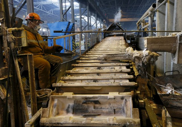 An employee controls production of aluminium at the Rusal Sayanogorsk aluminium smelter outside the town of Sayanogorsk, Russia, September 3, 2015. (Photo by Ilya Naymushin/Reuters)