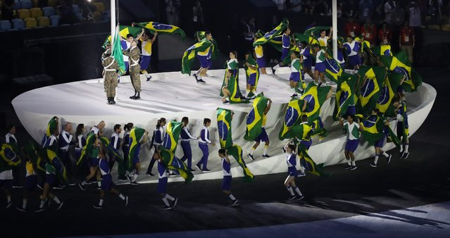 The Brazilian flag is raised during the Opening Ceremony of the Rio 2016 Olympic Games at the Maracana Stadium in Rio de Janeiro, Brazil, 05 August 2016. (Photo by How Hwee Young/EPA)