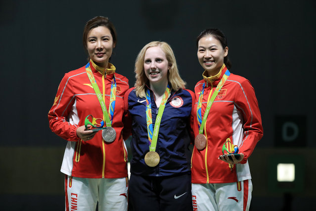 (L-R) Li Du of China with silver, Virginia Thrasher of the United States with gold and Siling Yi of China with bronze pose on the podium following the Women's 10m Air Rifle  on Day 1 of the Rio 2016 Olympic Games at the Olympic Shooting Centre on August 6, 2016 in Rio de Janeiro, Brazil. (Photo by Sam Greenwood/Getty Images)