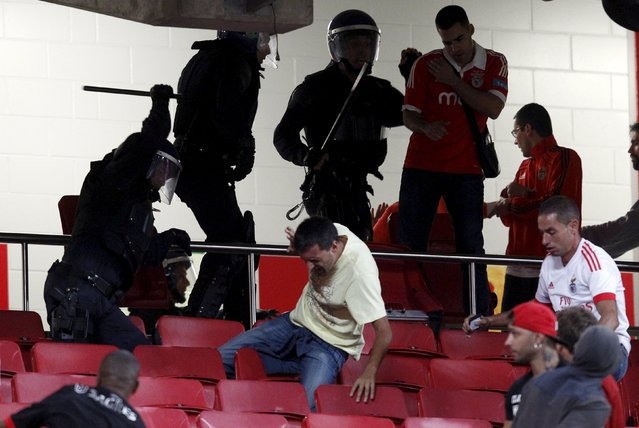 Riot police clash with Benfica supporters during their Portuguese Premier League soccer match against Belenenses at Luz stadium in Lisbon, Portugal, September 11, 2015. (Photo by Hugo Correia/Reuters)