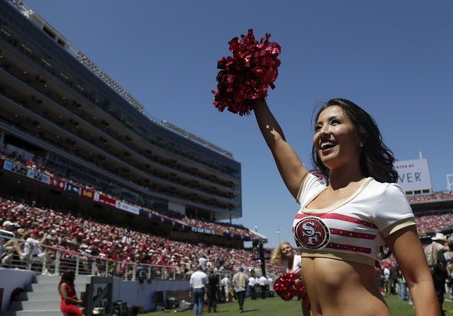 A San Francisco 49ers cheerleader performs during the first half of an NFL preseason football game against the Denver Broncos in Santa Clara, Calif., Sunday, August 17, 2014. (Photo by Marcio Jose Sanchez/AP Photo)
